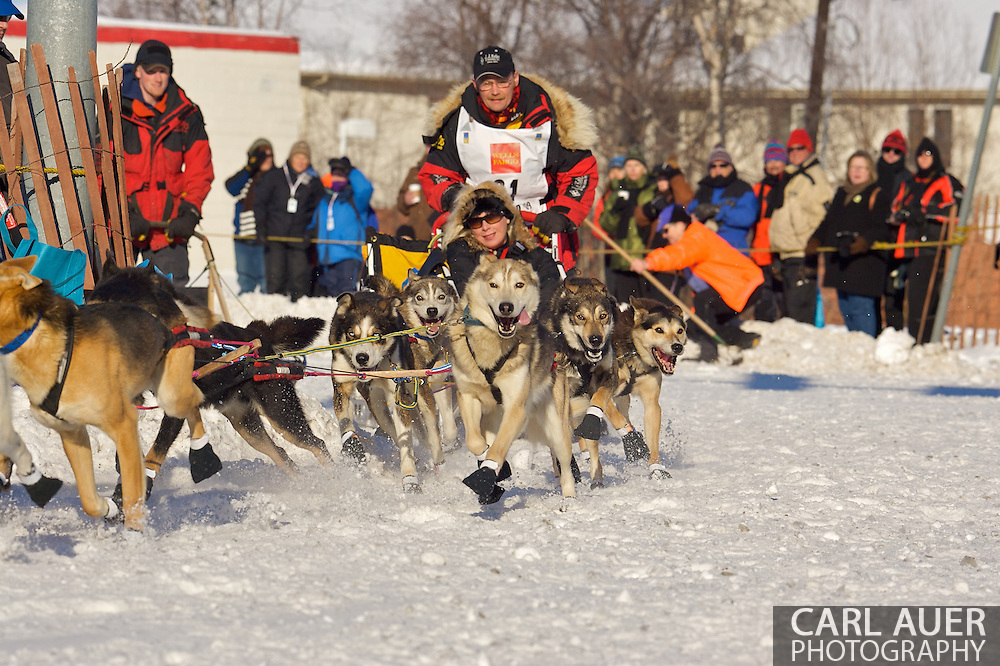 March 7th, 2009:  Anchorage, Alaska:  The team of Mitch Seavey from Seward, Alaska make the turn onto Cordova Street during the start of the 2009 Iditarod Sled Dog Race.