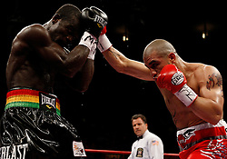 June 13, 2009; New York, NY, USA;  WBO Welterweight Champion Miguel Cotto and challenger Joshua Clottey trade punches during their 12 round bout at Madison Square Garden. Mandatory Credit: Ed Mulholland