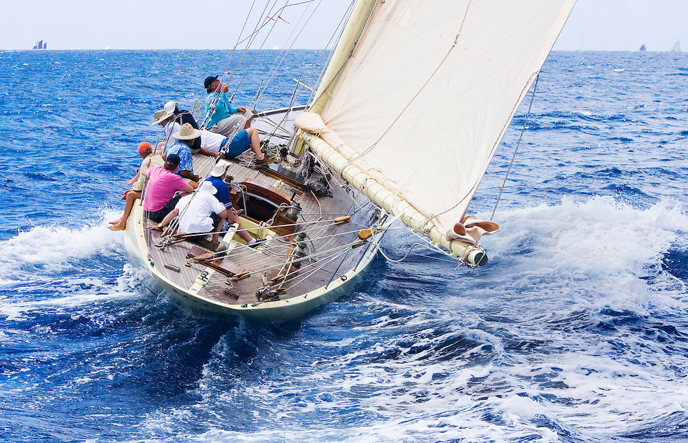 The gaff rigged sloop, whose name is SY Kate, with unidentified crew members during the 2008 Antigua Classic Yacht Regatta . This race is one of the worlds most prestigious traditional yacht races. It takes place annually off the costa of Antigua in the British West Indies. Kate is a Mylne designed international twelve meter