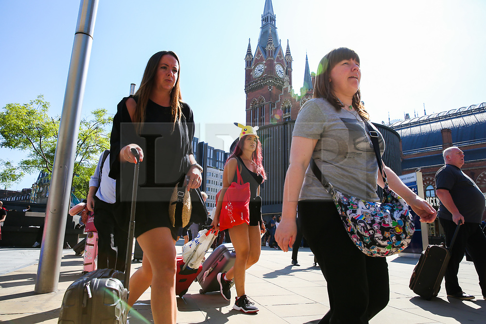 © Licensed to London News Pictures. 23/08/2019. London, UK. Passengers arrives with suitcases at London's Kings Cross rail station, which is due to be closed over the August bank holiday weekend. Rail services are being affected as works can take place to replace train tracks this weekend. Photo credit: Dinendra Haria/LNP