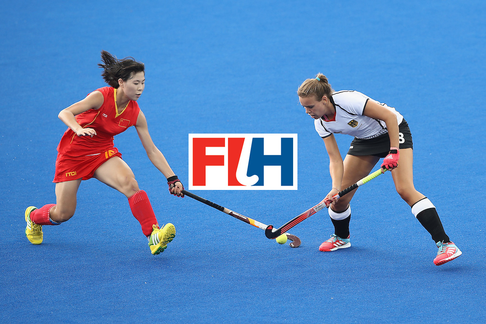 RIO DE JANEIRO, BRAZIL - AUGUST 07:   Zixia Ou of China and Anne Schroder of Germany compete for the ball during the women's pool A match between China and Germany on Day 2 of the Rio 2016 Olympic Games at the Olympic Hockey Centre on August 7, 2016 in Rio de Janeiro, Brazil.  (Photo by Mark Kolbe/Getty Images)