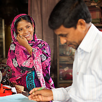 Jahanara signs up for a micro credit scheme with an agent. She will borrow Tk20,000 that will be invested in the purchase of building tools that she will rent out. <br />