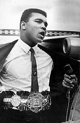June 3, 2016 - File - MUHAMMAD ALI, the three time heavyweight boxing champion, has died at the age of 74. He had been fighting a respiratory illness. 'The Greatest' was the dominant heavyweight boxer of the 1960s and 1970s, Ali won an Olympic gold medal in Rome in 1960, captured the professional world heavyweight championship on three separate occasions, and successfully defended his title 19 times. PICTURED: Oct. 28, 1964 - Florida, U.S. - October 28, 1964: MUHAMMAD ALI shows off his title belt. (Credit Image: © The Palm Beach Post via ZUMA Wire)