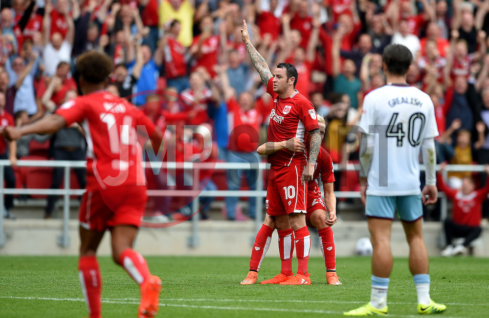 Lee Tomlin of Bristol City celebrates his goal as Jack Grealish of Aston Villa can only watch on  - Mandatory by-line: Joe Meredith/JMP - 27/08/2016 - FOOTBALL - Ashton Gate - Bristol, England - Bristol City v Aston Villa - Sky Bet Championship