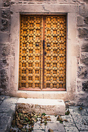 Wooden brown Carved criss-cross door, leaves in front, Croatia