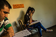 Students Paola Godoy and Nestor Melgarejo take their final tests in Guarani literature at the Instituto Superior de Lenguas, at Uniersidad Nacional de Asuncion, a public university in Asuncion, Paraguay, Wednesday, Dec. 13, 2017.  Paraguay today is trying to promote a positive image of Guaraní language but bilingual education programme is under resourced and has failed to reach many areas of rural or impoverished parts of Paraguay, where Guaraní speakers are still schooled through Spanish, leading many to drop out. Part of the issue is that the language taught in schools is not that of the streets, with teachers tending to be puritanical and teaching words that have long since fallen out of use. (Dado Galdieri for The New York Times)