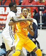 "Tennessee Volunteers forward Willie Carmichael III (24) is defended by Mississippi Rebels forward M.J. Rhett (4) at the C.M. ""Tad"" Smith Coliseum in Oxford, Miss. on Saturday, February 21, 2015. Mississippi won 59-57. (AP Photo/Oxford Eagle, Bruce Newman)"