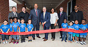 Baytown Mayor Brandon Capetillo cuts a ribbon with Harris County Department of Education Superintendent James Colbert and Head Start Director Venitia Peacock during a dedication ceremony for the new Baytown Head Start and Early Head Start facility, May 23, 2019.