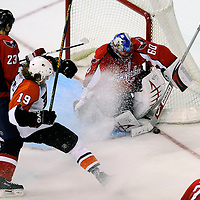 06 January 2009:  Washington Capitals goalie Jose Theodore (60) makes a save on shot by Philadelphia Flyers left wing Scott Hartnell (19) in overtime as Capitals defenseman Milan Jurcina (23) of the Slovak Republic skates in to defend at the Verizon Center in Washington, D.C.  The Capitals defeated the Flyers 2-1 in a shootout.