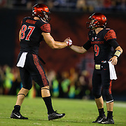15 September 2018: San Diego State Aztecs quarterback Ryan Agnew (9) and tight end Kahale Warring (87) celebrate after the Aztecs tie the game in the second quarter. The Aztecs beat the Sun Devils 28-21 at SDCCU Stadium in San Diego, California.