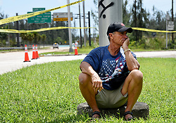 "Key Largo resident Warren Stincer, 64, sits frustrated that officials won't allow anyone into the Florida Keys Monday afternoon, September 11, 2017 because they don't know the full extent of the damage to infrastructure after Hurricane Irma cut through the Florida Keys Saturday and Sunday. ""First time evacuating and I'll never evacuate again,"" said Stincer, who's a boat captain. ""I'm concerned for my animals. I want to go home and there's no reason for them to keep me from my home."" Stincer has lived in Key Largo since he came to the United States from Cuba in 1956. ""There's no concern between here and my home."" Photo by Taimy Alvarez/Sun Sentinel/TNS/ABACAPRESS.COM"