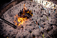 Scrolls and incense are burned at a small altar at a temple in Tokyo, Japan.