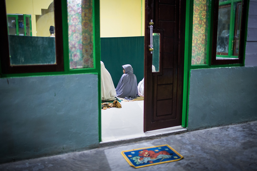 Every morning before dusk Reni attends the Morning Prayer with her mother and grandmother at a nearby mosque.