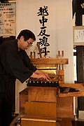"TOYAMA MEDICINE.Demonstration of traditional way of making pills at IKEDAYA YASUBEI SHOTEN a traditional medicine shop in Toyama city. Ikedaya-Yasubei Shoten preserves the atmosphere of a time-honored herbal medicine shop. ""Ecchu-hangontan"" written on it's front sign is said to be a miracle medicine that reinvigorates one's body. In the shop, visitors can watch a demonstration of making pills by using the traditional hand-operated pill maker. On the 2nd floor of the shop is the restaurant YAKUTO where healthy dishes made with Chinese herbal medicines are served. http://www.hangontan.co.jp/Toyama prefecture is located near the center of Japan and is approximatelythe same distance from the three largest cities in Japan-Tokyo,Nagoya,andOsaka. Toyama's pharmaceutical tradition has a more than 300 years history. As it is located on the Japan sea, it is facing China and has been an importer of traditional Chinese medicine knowledge which it developed through the years. There are now approximately 100 manufactures and over 100 factories in Toyama in terms of pharmaceutical products and Toyama prefecture acquires a steady reputation as Japan's medicine manufacturing base."