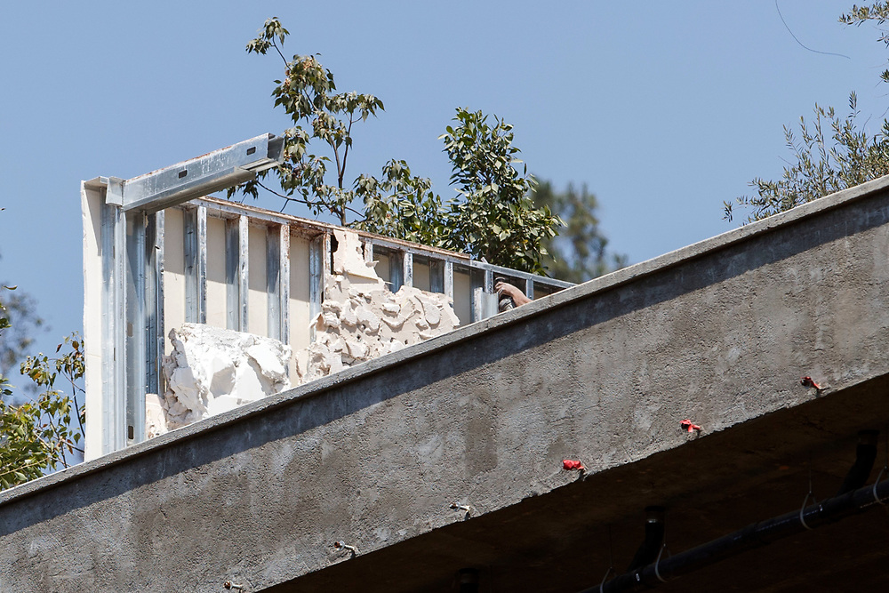 Crews work on demolishing part of the mansion of Mohamed Hadid at 901 Strada Vecchia as seen from the home of Joseph Horacek, located beneath Hadid's the Bel Air neighborhood on Wednesday, June 29, 2016 in Los Angeles, Calif. © 2016 Patrick T. Fallon for DailyMail.com