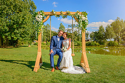 Bride and Groom on Wedding Swing at Toddington Fisheries, Bedfordshire