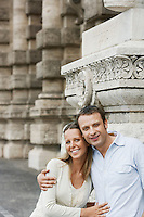 Couple by building pillars in Rome Italy portrait