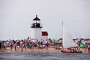 The Rainbow Fleet and Brant Point Lighthouse.