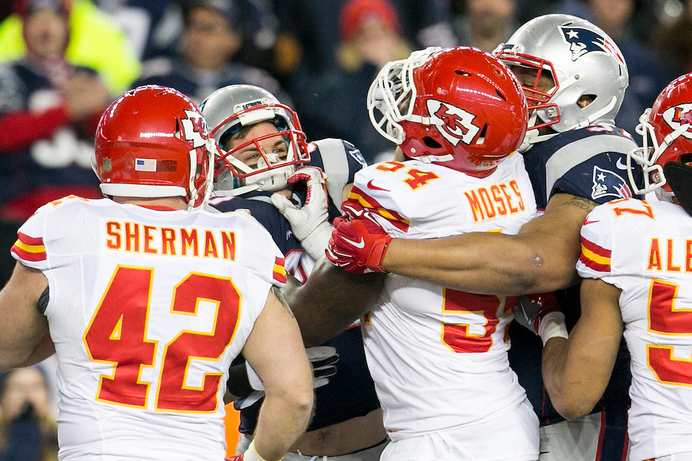 New England Patriots wide receiver Danny Amendola (80) and Kansas City Chiefs linebacker Dezman Moses (54) get in to a fight after a punt in the second quarter of AFC Divisional Playoff game at Gillette Stadium in Foxborough, Massachusetts on January 16, 2016.     Photo by Kelvin Ma/ UPI