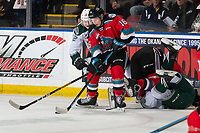 KELOWNA, BC - SEPTEMBER 28:  Max Patterson #12 of the Everett Silvertips back checks Michael Farren #16 of the Kelowna Rockets as he takes control of the puck at Prospera Place on September 28, 2019 in Kelowna, Canada. (Photo by Marissa Baecker/Shoot the Breeze)