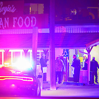 010113  Adron Gardner/Independent<br /> <br /> Gallup police interview patrons at Virgies Restaurant after a nearby shooting in Gallup Wednesday.