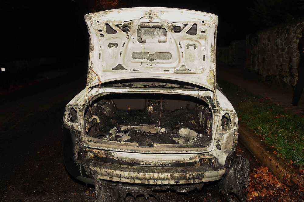 A 2001 Audi A6 caught fire and was put out by the fire department in Northwest Washington, DC.  Photo by Johnny Bivera