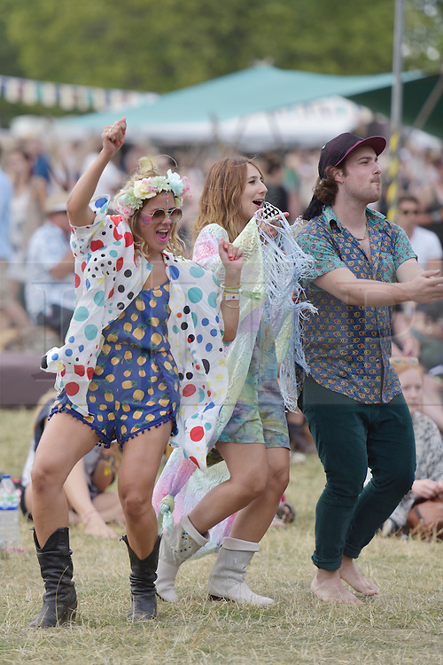 © Licensed to London News Pictures. 07/08/2015. Cornbury Park, Charlbury, Oxfordshire. Coraline Jade Charles and her friends dance. Wilderness Festival 2015 at Cornbury Park in Oxfordshire attracted crowds of 30,000. Photo credit : MARK HEMSWORTH/LNP