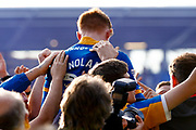 Shrewsbury Town fans celebrate victory with Shrewsbury Town midfielder Jon Nolan (20) during the EFL Sky Bet League 1 Play Off second leg match between Shrewsbury Town and Charlton Athletic at Greenhous Meadow, Shrewsbury, England on 13 May 2018. Picture by Simon Davies.