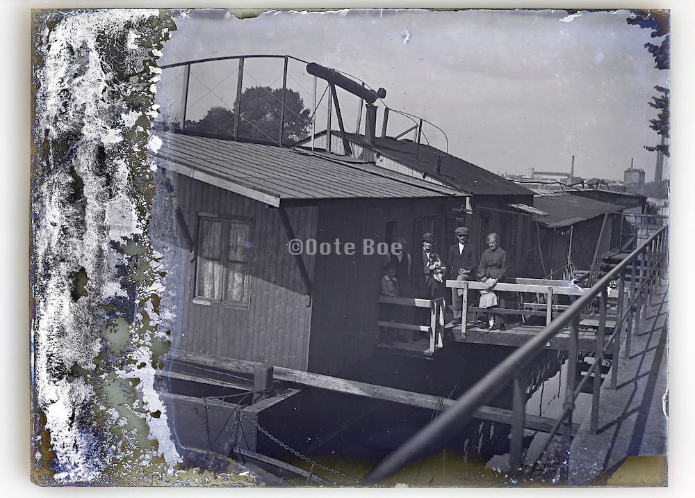eroding glass plate with family standing in front of houseboat Paris early 1900s