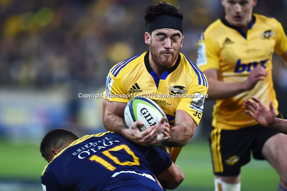 Nehe Milner-Skudder of the Hurricanes tackled by Lima Sopoaga. Super Rugby Final match between the Hurricanes and Highlanders at Westpac Stadium, Wellington, New Zealand. 4 July 2015. Copyright Photo: Andrew Cornaga / www.Photosport.nz