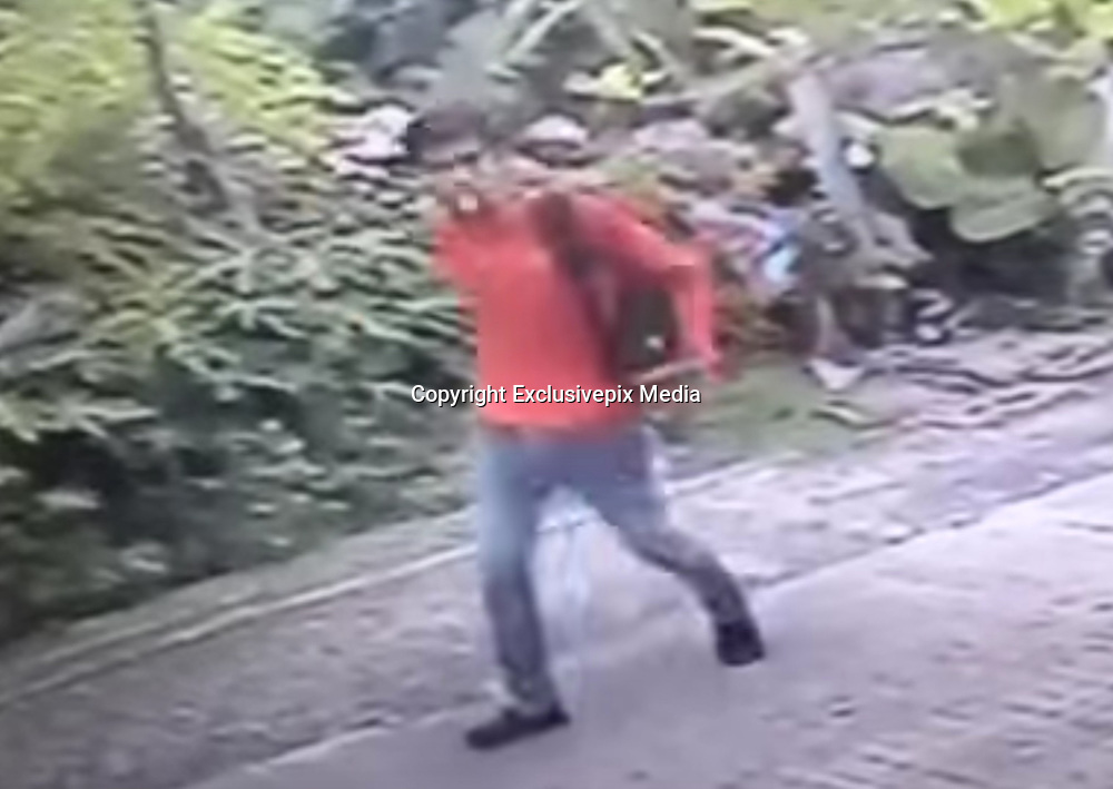 BANGKOK MAN LIVESTREAMS SLEEPING WOMAN THEN RAPES HER<br /> <br /> A standoff lasting seven hours at a hotel in southeast metro Bangkok ended Wednesday night with a man arrested on suspicion of livestreaming a woman as she slept and then raping her.<br /> <br /> Thanapol Nilpat opened fire on police as they tried to capture him at a hotel in Samut Prakan's Bang Phli district, leading to the long confrontation. No officers were injured.<br /> <br /> He eventually surrendered to police, who said he later confessed to the assault two weeks ago in Bangkok's Suan Luang neighborhood. Thanapol, they said, saw a sleeping woman through an open door of an apartment. He entered the room and began streaming video of her over Bigo Live, a Singapore-based social media service that has many users in Thailand.<br /> <br /> Thanapol said the woman woke up and at that point he sexually assaulted her before escaping. A security camera near the apartment caught him leaving the scene.<br /> ©Exclusivepix Media