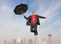Falling Businessman with Umbrella