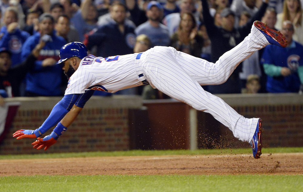 CHICAGO, IL - OCTOBER 15:  Jason Heyward #22 of the Chicago Cubs dives into third base while hitting a triple in the bottom of the second inning of Game 1 of NLCS against the Los Angeles Dodgers at Wrigley Field on Saturday, October 15, 2016 in Chicago, Illinois. (Photo by Ron Vesely/MLB Photos via Getty Images)  *** Local Caption *** Jason Heyward