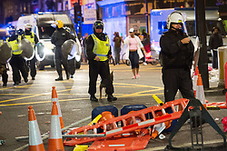 "July 28, 2017 - London, London, UK - Riot police try to take control of a riot situation seeking protesters on the streets of Dalston following the death of Rashan Charles whilst being arrested by police.  A statement from Scotland Yard said Mr Charles went into a shop, where he was seen ""trying to swallow an object"" and it was then police officers struggled with him to make an arrest. (Credit Image: © Ray Tang via ZUMA Wire)"