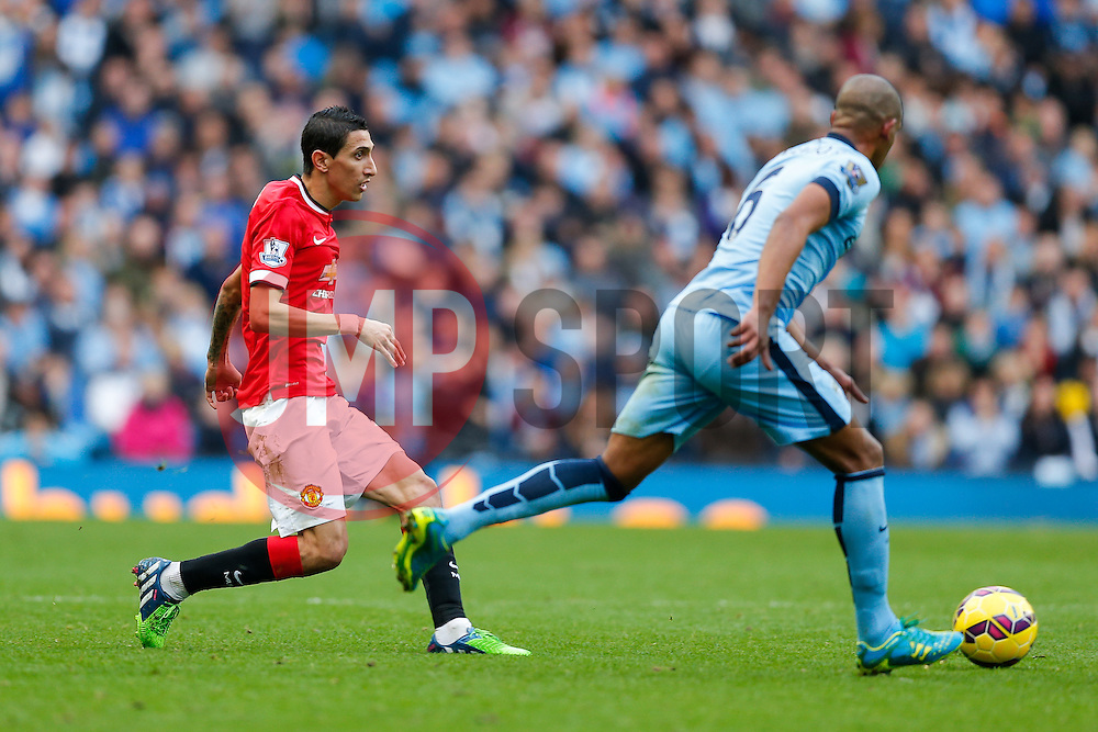 Angel Di Maria of Manchester United passes past Fernando of Manchester City - Photo mandatory by-line: Rogan Thomson/JMP - 07966 386802 - 02/11/2014 - SPORT - FOOTBALL - Manchester, England - Etihad Stadium - Manchester City v Manchester United - Barclays Premier League.