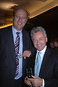 Chris Grayling and Alan Duncan. 'Dirty politics, Dirty times: My fight with Wapping and New Labour' by Michael Ashcroft. Book launch party in aid of Crimestoppers. Riverbank Plaza Hotel. London SE1.      October 10 2005. ONE TIME USE ONLY - DO NOT ARCHIVE © Copyright Photograph by Dafydd Jones 66 Stockwell Park Rd. London SW9 0DA Tel 020 7733 0108 www.dafjones.com