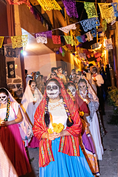 Young Mexicans dressed in costumes walk in a candlelit procession during the Day of the Dead festival November 1, 2018 in San Miguel de Allende, Mexico. The festival is celebrated across Mexico to remember loved ones that have passed away.