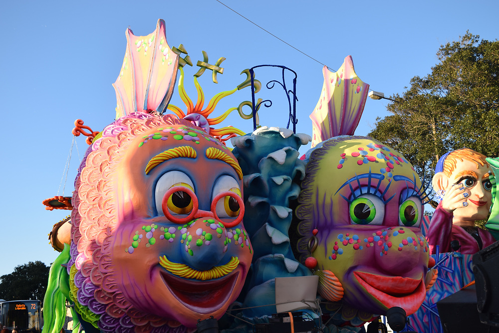 Male and female fish on a float, colourful, bright, blue sky