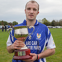Kilmaley Captain, Kenneth Kennedy with the ivision 2 Hurling League after their Final win against Wolfe Tones