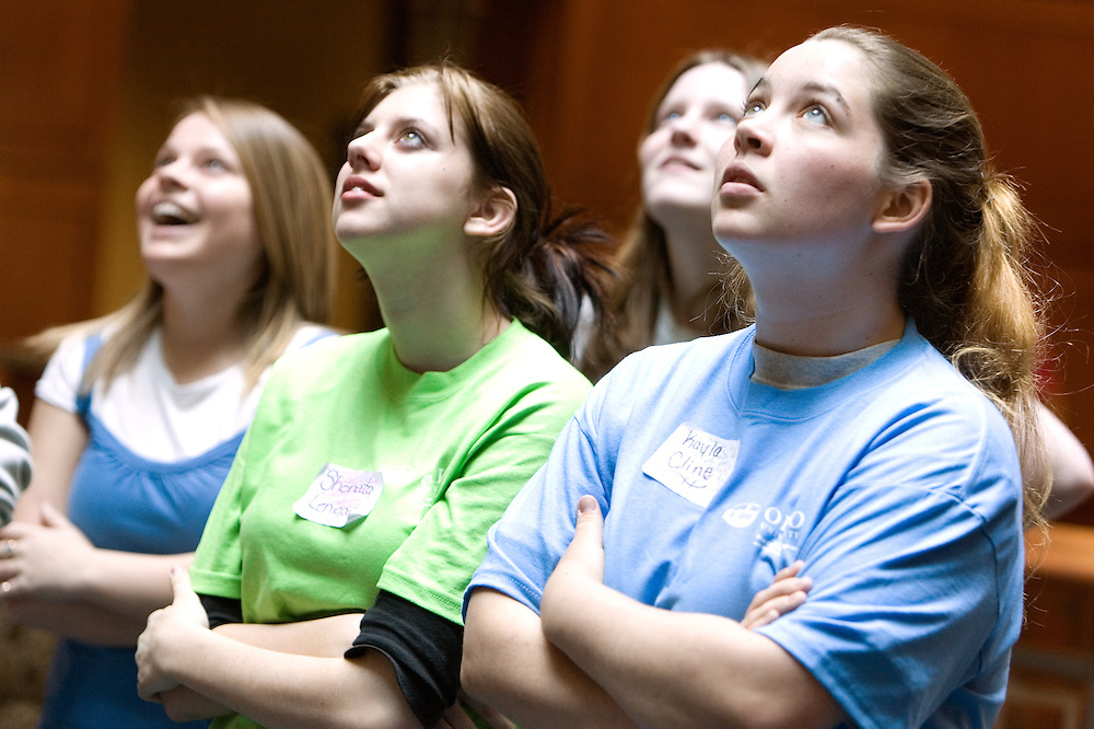 Katie Owen (from left), Shonata Lenigar, Annie Holbert and Kayla Cline anxiously watch their team's egg drop during the Russ College of Engineering and Technology research fair/engineering day in the Baker Center ballroom on Thursday, 5/3/07.