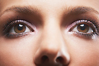 Young woman's eyes with eye shadow looking up