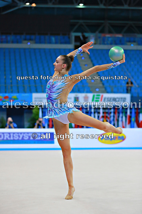 Volkova Ekaterina during qualifying at ball in Pesaro World Cup 10 April 2015. Ekaterina was born in Vantaa, Finland, 1997. She is a Finnish individual rhythmic gymnast.