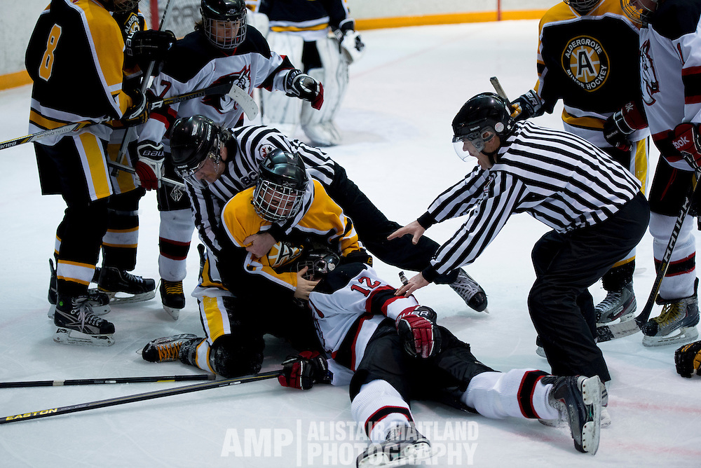Referees struggle to pull Aldengrove Bruin, Derek Gulka, off Mustang Captain Mike Arnold during the Midget A Mustang and Aldengrove game on Saturday night.