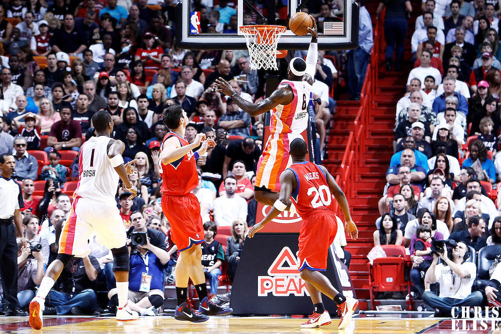 21 January 2012: Miami Heat small forward LeBron James (6) goes for the lay up during the Miami Heat 113-92 victory over the Philadelphia Sixers at the AmericanAirlines Arena, Miami, Florida, USA.