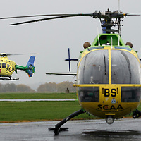 FREE TO USE PHOTOGRAPH....30.10.15<br /> Scotland's Charity Air Ambulance (SCAA) unveiled it's new helicopter at Perth airport this morning a EC135 T2i (pictured) which replaces the Bolkow 105 helicopter which is retiring from service. The new helicopter will increase speed, range, endurance and payload, allow SCAA to fly at night and in cloud. Picture shows the new EC135 T2i flying in past the retiring Bolkow.<br /> for further info please contact Maureen Young on 07778 779000<br /> Picture by Graeme Hart.<br /> Copyright Perthshire Picture Agency<br /> Tel: 01738 623350  Mobile: 07990 594431