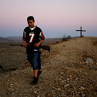 Brother of a murder victim visits his grave. Photographed for Southern Poverty Law Center.