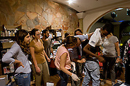 Roma 27 Giugno 2015<br /> Francesca Immacolata Chaouqui (L),ex componente della Commissione Cosea sulle strutture finanziarie del Vaticano, imputata al  processo Vatileaks, con i volontari al  centro di accoglienza  per migrati Baobab, vicino alla stazione Tiburtina.<br /> Al centro di accoglienza  per migrati Baobab, vicino alla stazione Tiburtina continua afflusso di migranti  provenienti soprattutto dall' Eritrea, ogni giorno circa 700 migranti mangiano al centro  e 300 sono ospitati la notte. Medici volontari controllano lo stato di salute dei rifugiati al centro Baobab.<br /> Francesca Immacolata Chaouqui (L), former member of Cosea Commission on the financial structures of the Vatican, imputed to the process Vatileaks,with the volunteers at the reception centre for immigrants, Baobab, in Tiburtina neighbourhood.<br /> Rome June 27, 2015<br /> At the Humanitarian emergency reception centre for immigrants, Baobab, in Tiburtina neighbourhood. continuous influx of migrants coming mainly from 'Eritrea, every day about 700 migrants eat in the centre and 300 are housed at night. Volunteer doctors monitor the health of refugees at the center Baobab.
