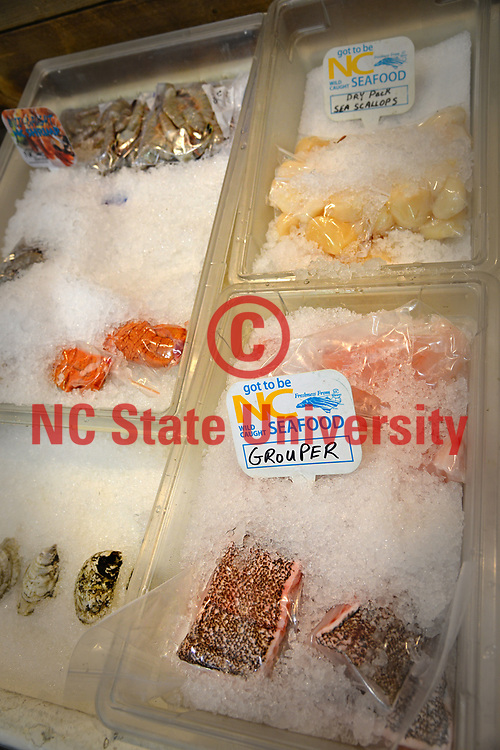 Fresh wild caught North Carolina seafood for sale at Locals Seafood at the NC State Farmers' Market.