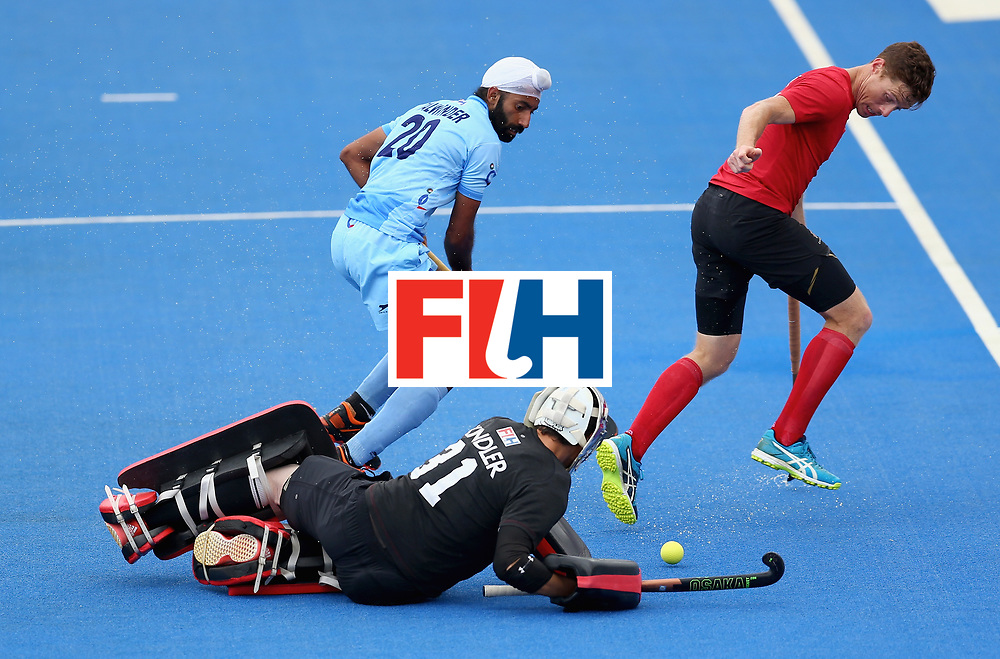 LONDON, ENGLAND - JUNE 25: Antoni Kindler of Canada saves a shot from Talwinder Singh of India  during the 5th/6th place match between India and Canada on day nine of the Hero Hockey World League Semi-Final at Lee Valley Hockey and Tennis Centre on June 25, 2017 in London, England. (Photo by Steve Bardens/Getty Images)