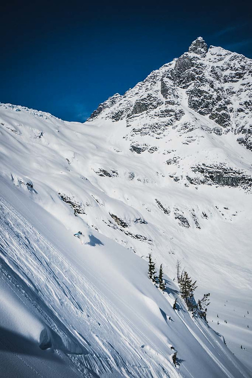 Dropping! Simon Thomson skiing below Loft Peak Glacier, howson Range, British Columbia.